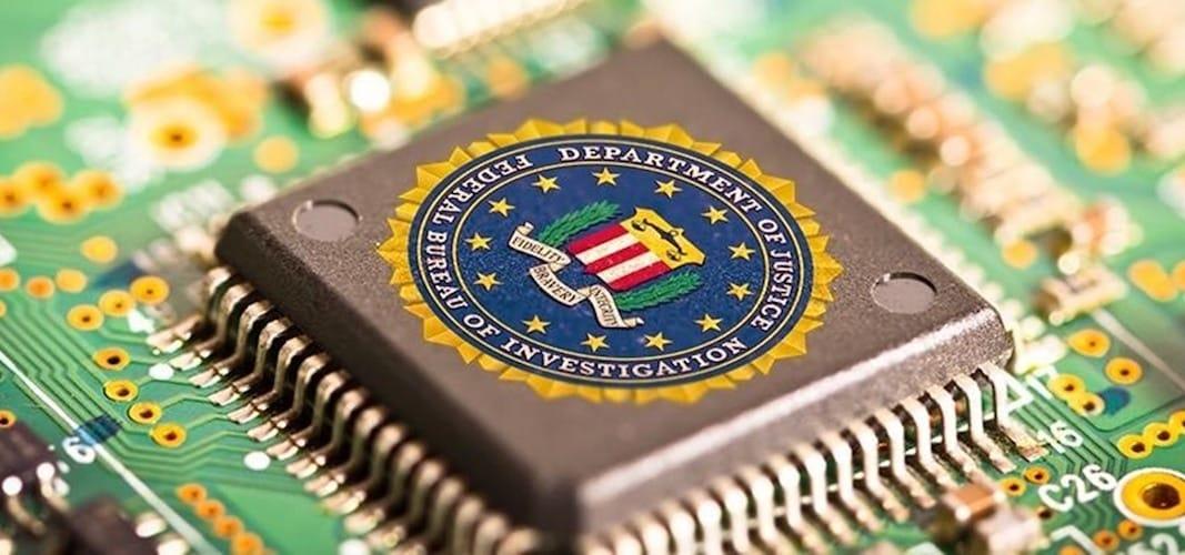 شعار مكتب التحقيق الفدرالي FBI على معالج اجهزة الايفون لفك التشفير